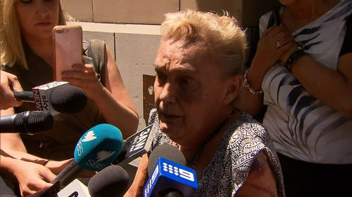 Julie Maybury, Kylie's mother, speaks with reporters outside court. (9NEWS)
