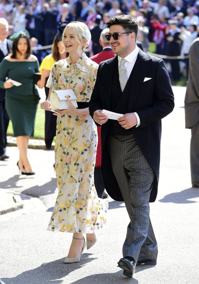 Actress Carey Mulligan in a pink and yellow floral dress, photographed with <strong>Marcus Mumford at Prince Harry and Meghan Markle's </strong>wedding