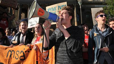 Students protest against proposed Abbott government changes to tertiary education at the State Library of Victoria in Melbourne.