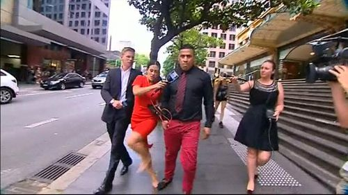 The moment reporter Leonie Ryan says she was stomped on by John Hopoate. (9NEWS)