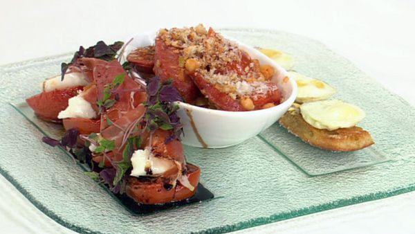 Breakfast tapas - roasted tomatoes with mozzarella and jamon