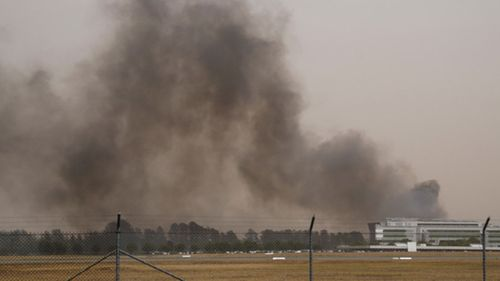Flights in and out of Canberra airport have been grounded as two bushfires burn in the ACT.