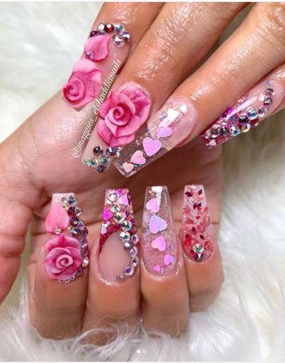 Glitter-embellished nails are one way to up your nail game this V Day.