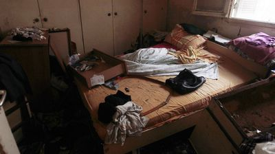 An interior room of a bedroom inside a house after flooding.