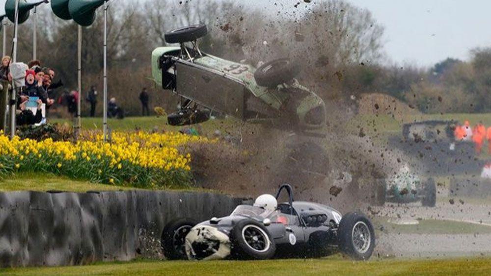 Race car narrowly misses spectators after terrifying flip