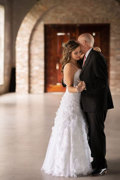Daughters stage wedding dance with their dying father