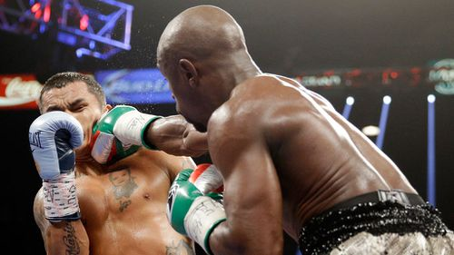 Floyd Mayweather punches Marcos Maidana, left, during their WBA welterweight and WBC super welterweight title fight in Las Vegas. (AAP)