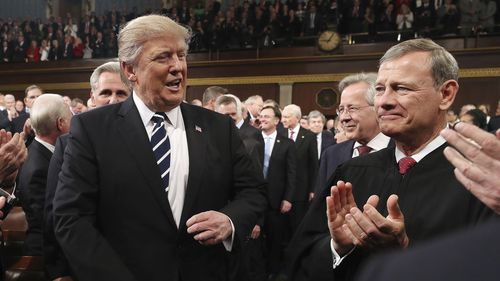 Chief Justice John Roberts (right) has issued a rare rebuke of President Donald Trump.