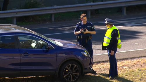 A 71-year-old man was hit and killed by an oncoming car on the M2 Motorway at Baulkham Hills, in Sydney's west, today. Picture: 9NEWS.