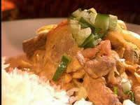 Quick lamb curry with tangy carrot salad