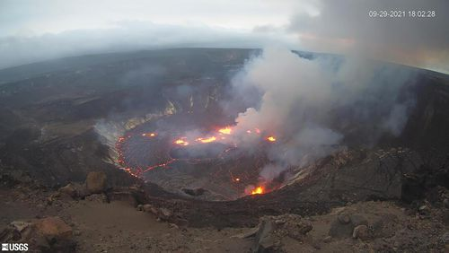 This webcam image provided by the United States Geological Survey shows a view of an eruption that has begun in the Halemaumau crater at the summit of Hawaiis Kilauea volcano, Wednesday, Sept. 29, 2021. (USGS via AP)