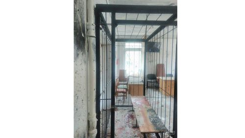 The cage in which the defendants sat during the trial. (Image: Ukrainian Police Facebook)