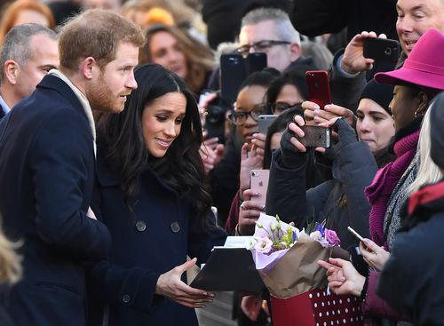 Harry and Meghan meet the public on their walkabout in Nottingham last Friday night. Picture: AAP