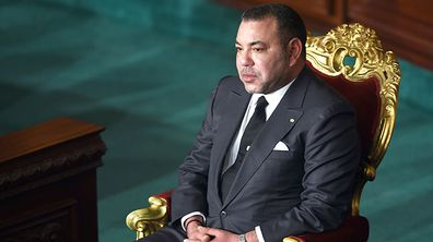 Moroccan King Mohammed VI listens during a session at Tunisia's Constituent Assembly. (Getty)