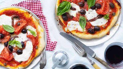 """Recipe: <a href=""""https://kitchen.nine.com.au/2016/05/16/15/15/mozzarella-tomato-olive-and-caper-pizza"""" target=""""_top"""">Mozzarella, tomato, olive and caper pizza</a>"""