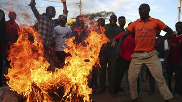 Supporters of the Kenyan opposition burn tyres in Nairobi. (AAP)