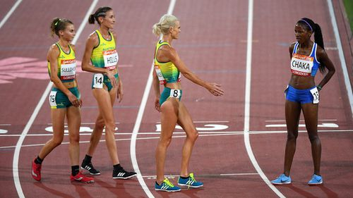 Australian 10,000m runners Eloise Wellings, Madeline Hills and Celia Sullohern waited for Lesotho competitor Lineo CHaka to finish to congratulate her. Picture: AAP.