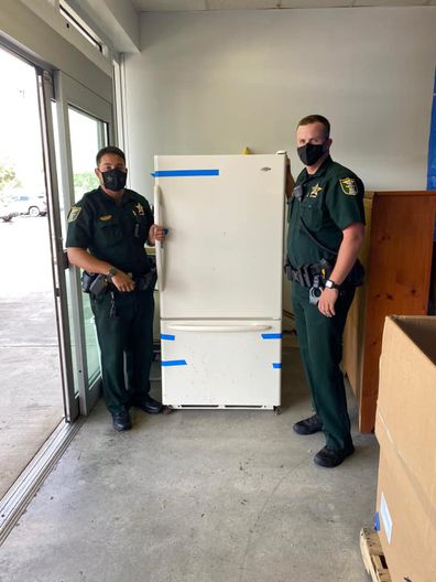 Police officers delivered a fridge when one Florida woman called them saying hers had broken down.