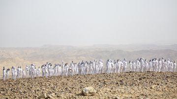 Hundreds gather nude in the scorching desert - for art
