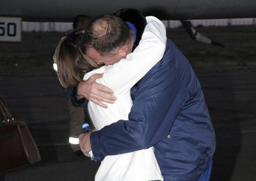 Hague embraces his wife Catie after the aborted mission.