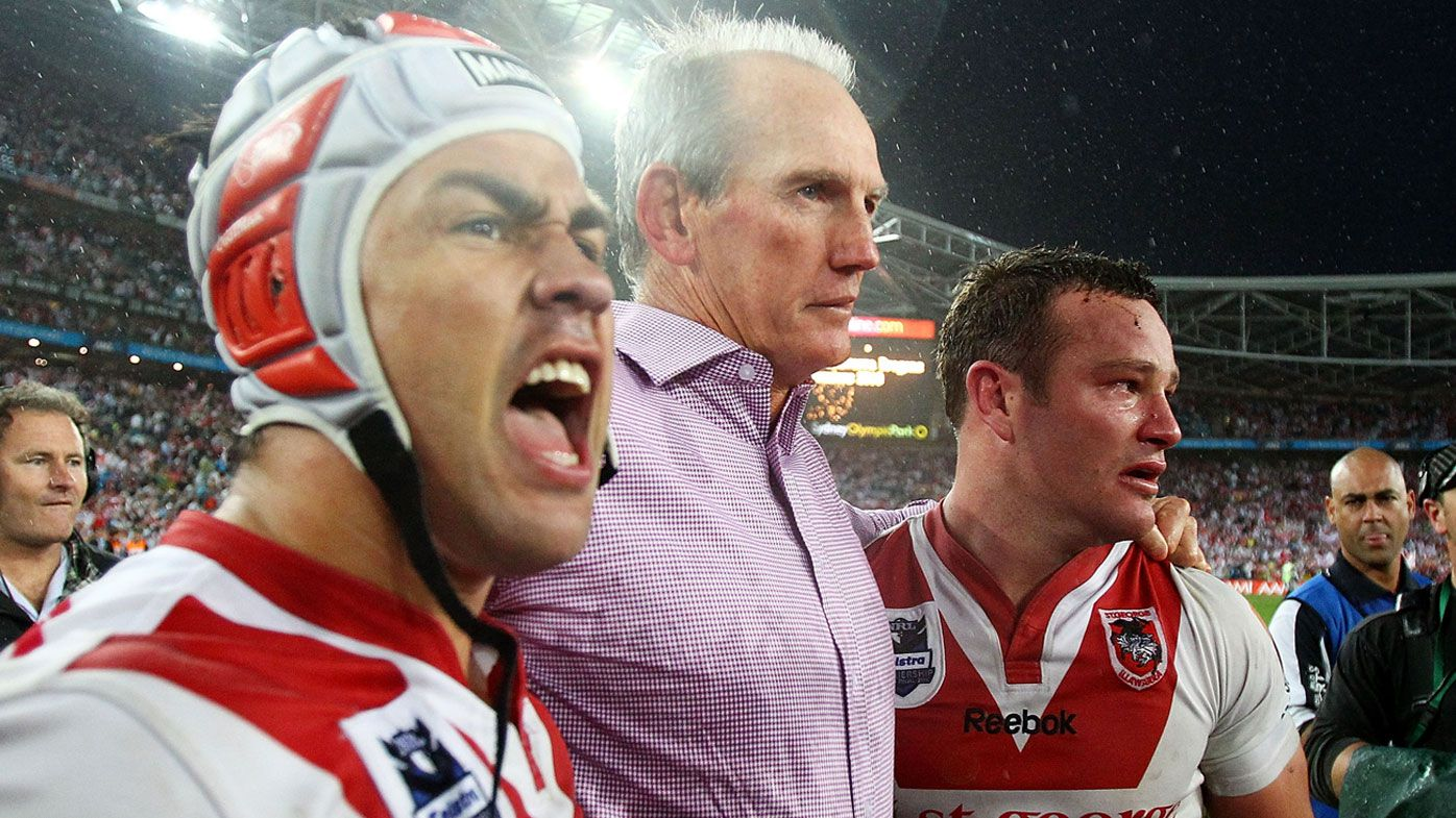 Wayne Bennett celebrates with Jamie Soward and Dean Young after the Dragons' 2010 NRL Premiership. (Getty)