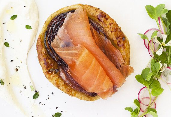 Whisky-cured salmon, roasted onion tarte tatin and fresh goat's curd