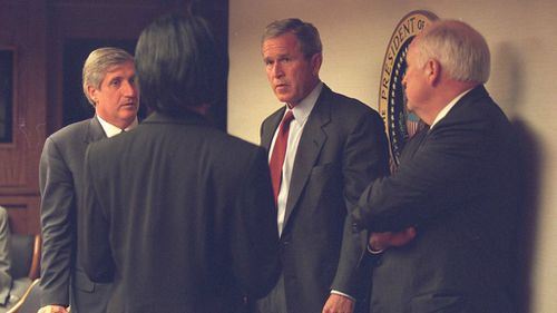 Historic photos show shock and sorrow of Bush administration on day of World Trade Center attacks