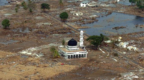 Only a mosque remains among the rubble after the 2004 tsunami. (Getty)