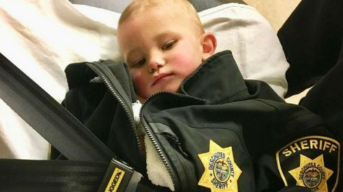 One-year-old Bradley Thomas was found naked by police, who wrapped him in a jacket.