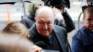 Archbishop Philip Wilson arrives at Newcastle Local Court today. The Adelaide Archbishop has been found guilty of concealing historical child sexual abuse. Picture: AAP