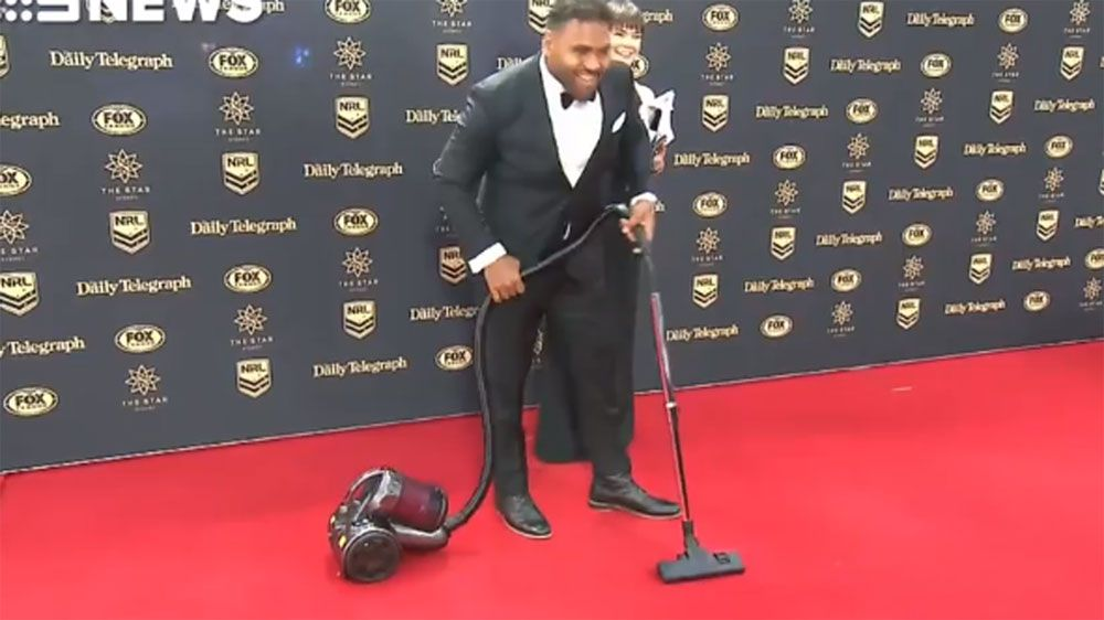 Brisbane Broncos forward Sam Thaiday arrives at NRL Dally M awards red carpet with a vacuum cleaner