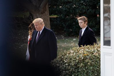 Donald and Melania Trump with their son Barron prior to their departure from the White House in Washington, DC., on Tuesday, November 20, 2018.