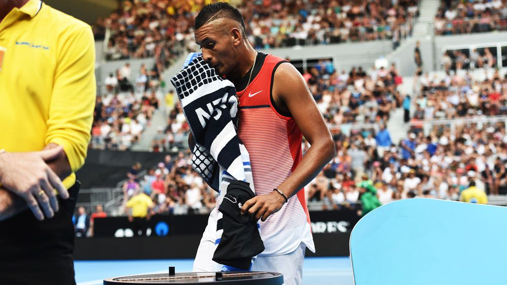 Nick Kyrgios goes to change his shorts. (AAP)