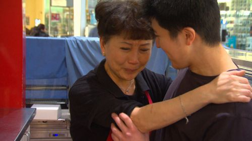 Distraught former franchisee Jenny Teng with her son.