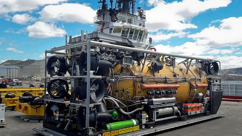 A US Navy pressurized rescue module sits on the dock before being loaded on a search ship. (Photo: AP).