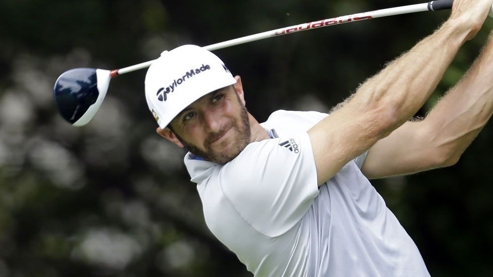 Dustin Johnson surged into a share of the lead of the BMW Championship. (AAP)