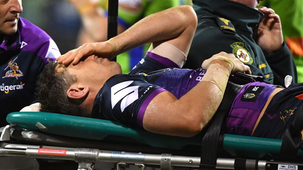Melbourne Storm fullback Billy Slater was assisted from the field after sustaining a high tackle. (AAP)
