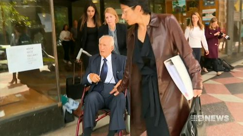 The 96-year-old was accused of indecently touching two female carers at his Vaucluse in Sydney.
