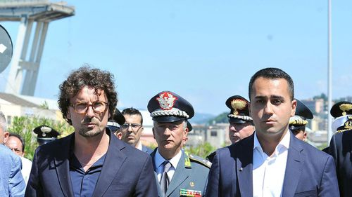 Italian Transport and Infrastructure Minister, Danilo Toninelli, left, and Deputy Premier Luigi Di Maio at the disaster site.