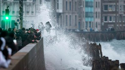 A wall of water as high as a four-storey building swept up the estuary. But the festive atmosphere was tempered by news of two drownings.