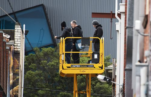 Spencer Tunick and his crew scope out the spot for this morning's nude shoot at Prahran. Picture: AAP