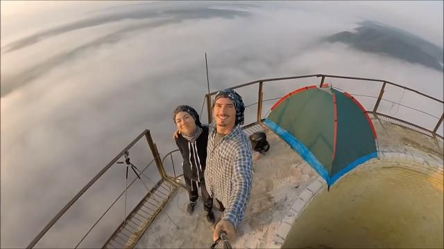 Friends take camping to the extreme with tent perched atop a chimney