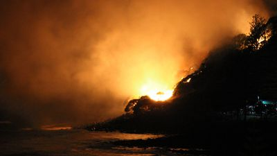 Flames tore through the headland shortly after 6.30pm. (Scott Hawkins)