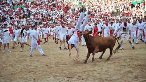 The population of Pamplona quintuples during its annual festival.