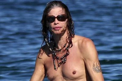 No, this isn't Janice Dickinson. It's just Steve Tyler, flaunting his moobs on vacation in Maui.