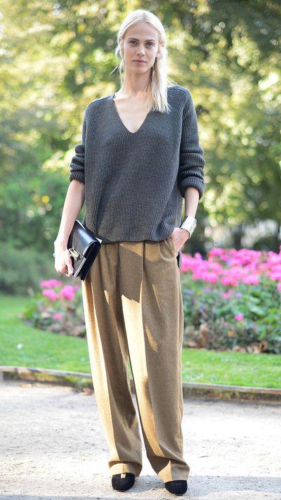 <p>Wearing an Hermès sweater and wide-leg wool pants during Paris Fashion Week.</p>