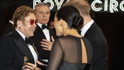 The Duke and Duchess of Sussex speak with Elton John at The Lion King premiere in London in 2019.
