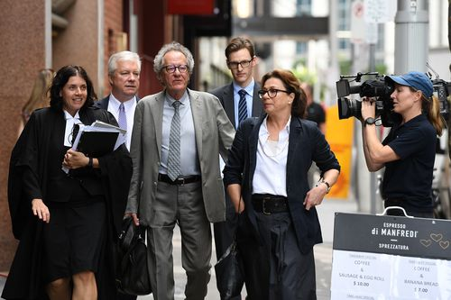 Geoffrey Rush's defamation case could be delayed to next year if a mystery witness comes forward.