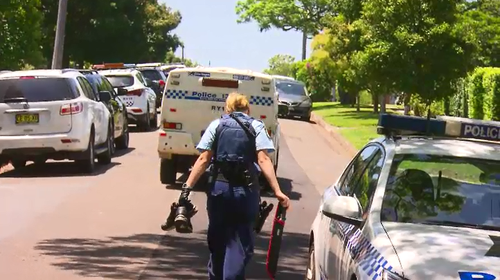 Police collected the machete, a laptop, shoes and a mobile phone as evidence after the crash.