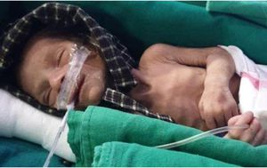 Newborn baby found buried alive fighting to survive